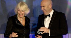 Richard Flanagan is congratulated by Camilla, Duchess of Cornwall as he is presented with the Man Booker prize. Photograph: Alastair Grant/Getty Images