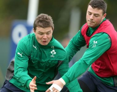 Brian O'Driscoll and Robbie Henshaw during an Ireland training session. The former captain has tipped the young Connacht player to fill the number 13 shirt in his absence.  Photograph: Dan Sheridan / Inpho