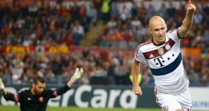 Bayern Munich's Arjen Robben celebrates scored twice against   AS Roma  at the Olympic Stadium in Rome. Photograph: Stefano Rellandini / Reuters