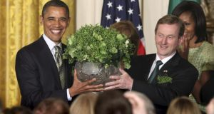 US President Barack Obama receives a bowl of shamrock from Taoiseach Enda Kenny during a St Patrick's Day reception at the White House, a fixed annual privilege granted to no other world leader.  Photograph: Chris Kleponis/ Reuters
