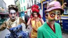 Macnas performers Helen Gregg, Yvette Picque and Debbie Wright in Galway's Quay Street in preparation for the Halloween parade Symphony for the Restless. Photograph: Joe O'Shaughnessy