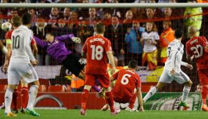 Real Madrid's Cristiano Ronaldo (2nd right) scores the opening goal against Liverpool   at Anfield. Photograph: Phil Noble / Reuters