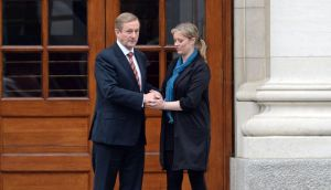 Taoiseach Enda Kenny with Maíria Cahill after their meeting at Government Buildings yesterday. Photograph: Eric Luke