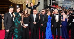 Benedict Cumberbatch 'photobombed'  U2 at the Oscars earlier this year. The word photobomb has been named word of the year by Collins English Dictionary.
