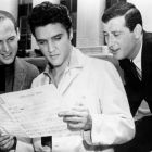 Elvis Presley with songwriters Jerry Leiber, left, and Mike Stoller looking over the sheet music for Jailhouse Rock in 1957. Photograph: Michael Ochs Archives/Getty Images