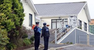 Gardaí outside a house in Carndonagh Co Donegal where Jimmy and Kathleen Cuddihy were found dead. Photograph: Paul Faith/PA Wire