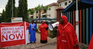 Campaigners shout slogans during a rally in Abuja,  calling for the release of the Chibok school girls who were abducted by Boko Haram. Photograph: Afolabi Sotunde/Reuters