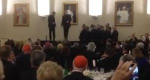 Screengrab from YouTube of Rev David Rider and Rev John Gibson on stage during a fundraiser at the North American College in Rome last April. Screengrab from YouTube