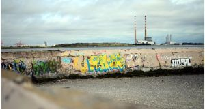 The chimneys of the ESB Poolbeg station from Sandymount Strand, Dublin. Photograph: Bryan O'Brien