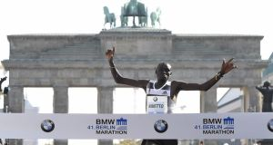Kenya's Dennis Kimetto crosses the line in Berlin as he completes the fastest marathon in history – his 2:02:57 breaking the 2:03-barrier for the first time. Photo: Tobias Schwarz/Getty