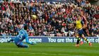 Arsenal's Alexis Sanchez scores the first of his two goals past Sunderland goalkeeper Vito Mannone during the  Premier League  match at the Stadium of Light. Photograph: Andrew Yates/Reuters