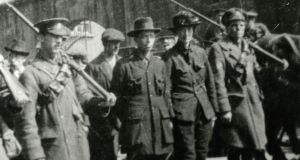 Michael Mallin and Countess Markievicz being escorted away by government troops, Easter Rising 1916. Photograph: National Museum of Ireland
