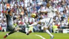 Real Madrid's Karim Benzema tries to nick the ball past Barcelona goalkeeper Claudio Bravo. Photograph: EPA/Juan Hidalgo