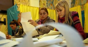 Members of a local electoral commission count ballots after the elections in Kiev, Ukraine. Photograph: Tatyana Zenkovich/EPA