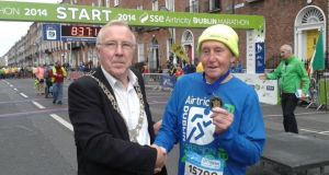 Dublin Lord Mayor Christy Burke is seen with John Collins (83) at the start line for this year's marathon. Mr Collins is running his 30th Dublin marathon and has been awarded the Lord Mayor's medal. Photograph: via Twitter