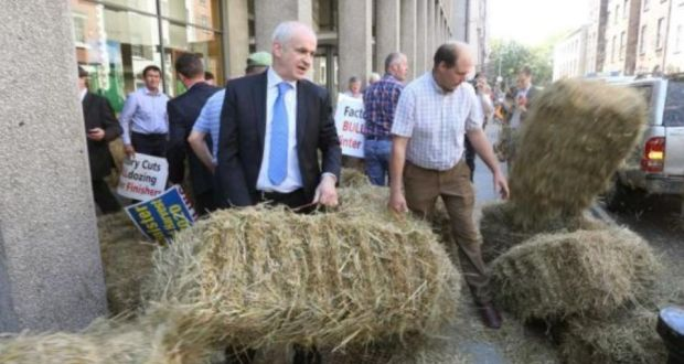 Farmers led by IFA president Eddie Downey (front left) and IFA national livestock chairman Henry Burns at the Department of Agriculture in June during a protest over cattle prices. Photograph: Finbarr O'Rourke