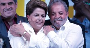 Dilma Rousseff celebrates victory with her mentor Lula da Silva, who campaigned tirelessly for her election. Photograph: AP Photo/Eraldo Peres