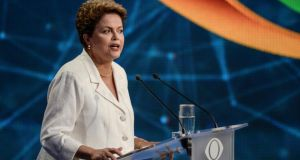 Brazil slumps after incumbent Dilma Rousseff narrowly wins a second term. Photograph: Paulo Fridman/Bloomberg