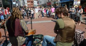 Buskers on  Grafton Street.  New bylaws would require buskers to pay to perform on Dublin's streets and would set time limits on performances. Photograph: Brenda Fitzsimons.