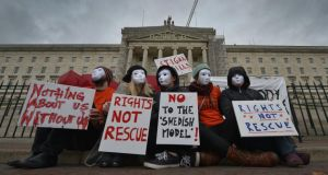 'Independent research by Northern Ireland's Department of Justice showed that no locally-based sex workers surveyed supported criminalising the purchase of sex.' Above, sex workers wearing masks to protect their identity protested against the  human trafficking Bill at Stormont last week. Photograph:  Charles McQuillan/Getty Images