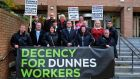 Members of the Mandate trade union and Dunnes Stores workers outside the Labour Court today where they attended a hearing. They are looking for secure working hours and earmings for all workers in the company. Photograph: Aidan Crawley/The Irish Times