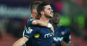 Shane Long celebrates scoring Southampton's second goal in their League Cup fourth round victory over Stoke City at Brittannia Stadium. Photograph: Getty.