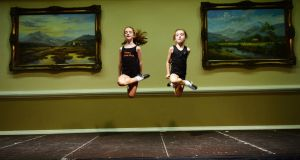 Emma Chambers and Ella McCarthy from Céim Óir Irish dancing school in London, preparing to compete at the Oireachtas Rince na hÉireann All Ireland Dancing Championships 2014 in Citywest Hotel in Dublin. Photograph: Alan Betson / The Irish Times
