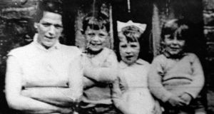 A family photo of Jean McConville with three of her children, taken shortly before she disappeared from her home in Belfast in 1972. Photograph: Paul McErlane/Reuters