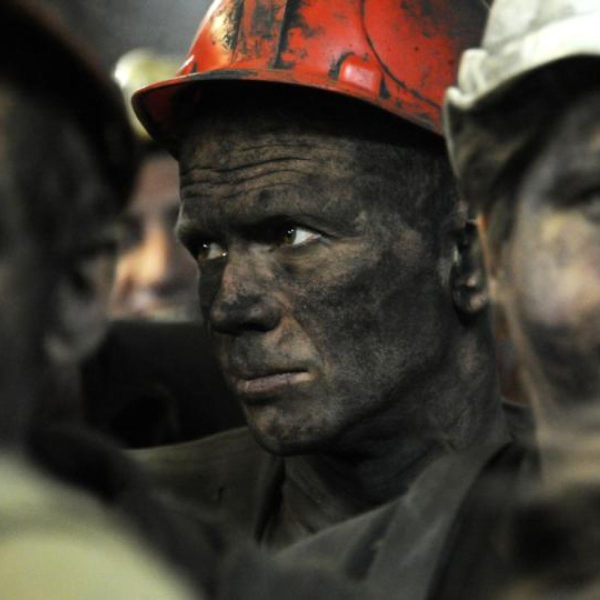 Donetsk miners dream of peace amid din of airport battle