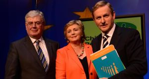 Frances Fitzgerald with Taoiseach Enda Kenny and former tánaiste Eamon Gilmore. Photograph: Bryan O'Brien