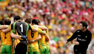 New Donegal manager Rory Gallagher was formerly a selector under Jim McGuinness. Here he departs a team huddle prior to the start of the All-Ireland semi-final in 2012. Photograph: James Crombie/Inpho