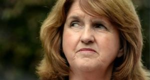Tánaiste Joan Burton said the time lines on the roll out of water metering had been 'far more ambitious than has actually been realised'.