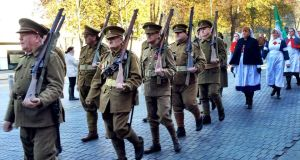 Re-enactors dressed in British first World War uniforms stage  a parade in Kilkenny city to remember the county's war dead. Photograph: Ronan McGreevy