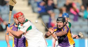 Rathdowney Errill's Joe Fitzpatrick prepares to clear as  Jude Sweeney of Kilmacud Crokes closes in at Parnell Park. Photo: Photo: Tommy Grealy/Inpho