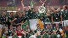 The Ireland rugby squad celebrates the Six Nations Grand Slam  victory over Wales in Cardiff. Photograph: Alan Betson