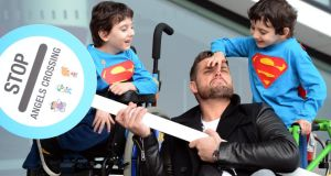 Former conjoined twins Hassan (left) and Hussein Benhaffaf , with Keith Duffy at the launch of the Irish Wheelchair Association fundraising campaign Angels , in Dublin today.Photograph: Eric Luke / The Irish Times