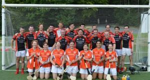 Sarah Kenny (bottom row centre) with the Holland Ladies and Amsterdam GAC teams