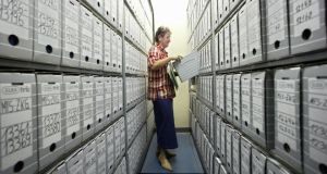 An employee of the Stasi archives searching for documents in the files department in Berlin.