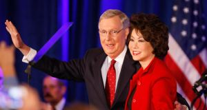 United States Senator Mitch McConnell, Republican of Kentucky, waves to supporters with his wife Elaine Chao during his victory celebration at the Marriott East Hotel in Louisville, Kentucky yesterday. Photograph: Mark Lyons/EPA