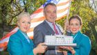Aer Lingus  chief executive Christoph Mueller with cabin crew members Anna Moore and Jillian McDonald at the announcement of the new Washington service.
