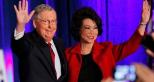 Mitch McConnell with his wife, former US secretary of labour Elaine Chao, at his midterm election night rally in Louisville, Kentucky, on Tuesday. Photograph: John Sommers II/Reuters