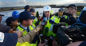 Hot water: Irish Water chief executive John Tierney, accompanied by Minister for the Environment Alan Kelly, talks to journalists at Ringsend waste-water treatment plant. Photograph: Cyril Byrne