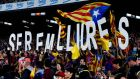Pro-Independence supporters hold up letters that reads 'We will be free' during the La Liga match between FC Barcelona and Celta de Vigo at Camp Nou last weekend. Photograph:  David Ramos/Getty Images