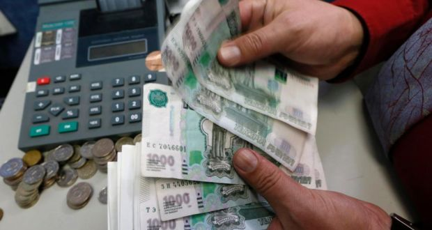 An Employee Counts Russian Rouble Banknotes At A Private Company S Office In Krasnoyarsk Siberia