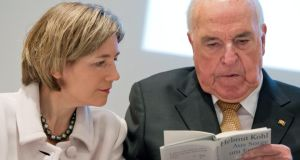 Former chancellor Helmut Kohl flicks through his new book with his wife Maike Richter-Kohl. Photograph: EPA/Boris Roessler