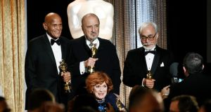 Honorees (l to r), singer and social activist Harry Belafonte,  screenwriter Jean-Claude Carriere, actress Maureen O'Hara and Japanese film director and animator Hayao Miyazaki. Photograph: Kevork Djansezian/Reuters
