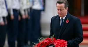 Britain's prime minister David Cameron lays a wreath at the annual Remembrance Sunday ceremony at the Cenotaph in London. Photograph: Luke MacGregor/Reuters