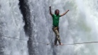 Rope walkers tackle the famous Victoria Falls. Video: Reuters