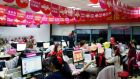 Employees of  Tmall, which sells underwear on Alibaba, work online to serve customers and deal with orders overnight in Hangzhou yesterday.  Photograph: Aly Song/Reuters