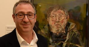 Nick Miller, winner of the Hennessy prize, with his portrait of Barrie Cooke, entitled Last Sitting, at the National Gallery yesterday. Photograph: Cyril Byrne/The Irish Times